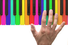 Rainbow piano keyboard with hand Royalty Free Stock Photos