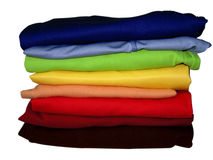 Rainbow pile of clothes on white with path Stock Photo