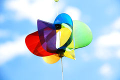 Rainbow pinwheel and sky Stock Images