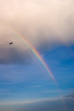 Rainbow and Plane Stock Photos