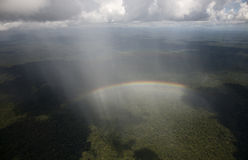 Rainbow in PNG. Flying in a helicopter in papua new guinea, above this misty vega below the clouds, when for a moment I looked out the door and noticed this Stock Photography