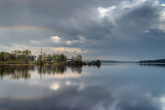 Rainbow in the pond. Before the storm Stock Photography