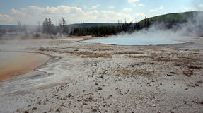 Rainbow Pool hot spring and Sunset Lake geyser in Black Sand Basin in Yellowstone National Park in Wyoming USA. Rainbow Pool hot spring and Sunset Lake geyser in Royalty Free Stock Photography