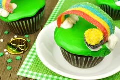 Rainbow pot of gold St Patricks Day cupcake. Close up on plate Royalty Free Stock Photos