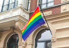 The rainbow pride LGBT flag blows in the wind royalty free stock images
