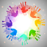 Rainbow prints of children hands and watercolor splashes. In the circle. Vector frame for postcards and your design Stock Image
