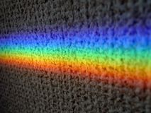 Rainbow prism on texture background Stock Photography