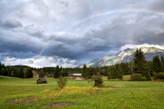 Rainbow after rain in Alps Royalty Free Stock Photography