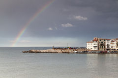 Rainbow after the rain, in a Costa Brava little town. The rainbow over the sea at a fisherman's little town Stock Photos