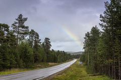 Rainbow. After the rain in Finnish Lapland stock photography