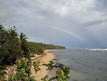 A Rainbow After the Rain in Linao. An Aerial View of a Seashore in Barangay Linao stock photos