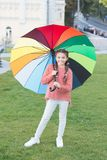 Rainbow after rain. Positive mood in autumn rainy weather. Optimist and cheerful child. Spring style. Little girl under royalty free stock images