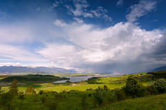 Rainbow after rain. Spring rain and storm in mountains Stock Image