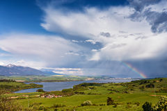 Rainbow after rain. Spring rain and storm in mountains Stock Photography