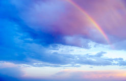 Rainbow and Rainclouds during Sunset. Cloudscape of rainbow and rainclouds during sunset Stock Image