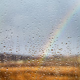 Rainbow through rained window. With droplets Royalty Free Stock Photos