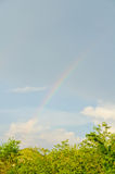 Rainbow at after rainning time. Sunset time, dusk, dawn on the lake  or pond Royalty Free Stock Photo