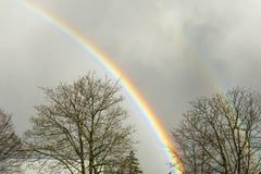 Rainbow on a rainy day Stock Images