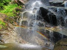 Rainbow Reflected Beneath Beaver Meadow Falls in Adirondacks stock images