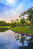 Rainbow reflection in the pond. This shot is taken in a public park in Bangkok, Thailand Stock Photography