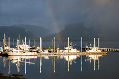 Rainbow Reflections. Rainbow in the boat harbor at Tenakee Springs, Alaska Royalty Free Stock Images