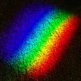 Rainbow refracted on the floor Stock Photos