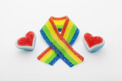 Rainbow ribbon with two hearts made of candy.  Royalty Free Stock Photo