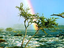 Rainbow on river stock photo