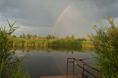 Rainbow on  the river Stock Photography