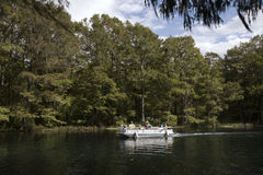 Rainbow River Dunnellon Florida USA. American rivers Rainbow river Florida USA boat pontoon people boating tourists people recreational recreation underway stock photos