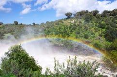 Rainbow on river Stock Image