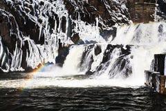 Rainbow on river waterfall Stock Photo