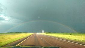 Rainbow. Roadtrip driving rural Royalty Free Stock Photography