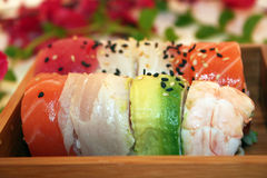 A Rainbow Roll of Sushi. A delicious rainbow roll of sushi includes tuna, shrimp, albacore, white fish, salmon avocado and more. A Japanese Favorite royalty free stock image
