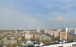 Rainbow and rooftops city Royalty Free Stock Photo