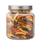 Rainbow Rotini Pasta in a Glass Jar Royalty Free Stock Photography