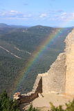 Rainbow and ruin. Castle of Peyrepertuse,Aude,Languedoc region of France Stock Photos