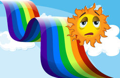 A rainbow beside the sad sun Stock Photos
