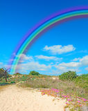 Rainbow and sand Royalty Free Stock Image