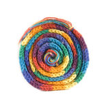 Rainbow scarf curled up. A colourful rainbow scarf curled up into a ball, isolated on white Royalty Free Stock Image