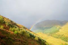 Rainbow in Scottish Highlands UK stock photo