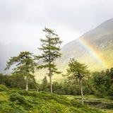 Rainbow in Scottish Highlands valley Stock Photo