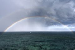 Rainbow and sea. The rainbow over a sea stock photography