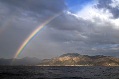 Rainbow,sea and island Stock Image
