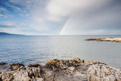 Rainbow at the sea. Rainbow over the mediterranean landscape from a bay Royalty Free Stock Photo