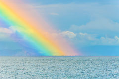 Rainbow seascape after the rain above the sea waves surface Stock Photo