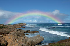 Rainbow on seashore. The beautiful rainbow show on seacaost , rainbow bridge Stock Image