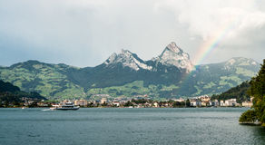 Rainbow shines after a rain on Lucerne lake stock images