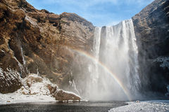 Rainbow shining at Skogafoss waterfall Stock Images