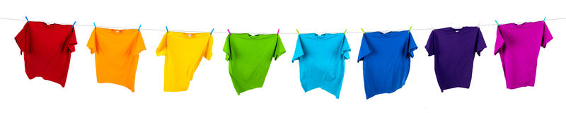 Rainbow shirts on line. Rainbow shirts on washing line royalty free stock image